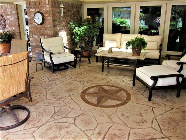 white chairs on brown stamped concrete